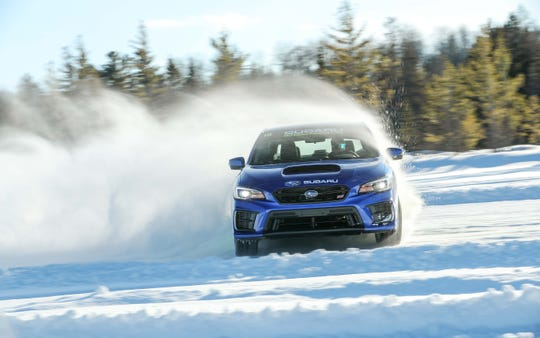 Thanks to its all-wheel-drive system and studded winter tires, the Subaru WRX STI negotiates turns at lurid 90-degree angles.