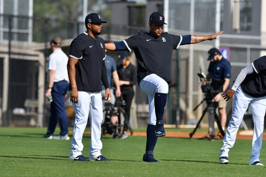 Miguel Cabrera does stretching exercises on Monday in Lakeland, Fla.