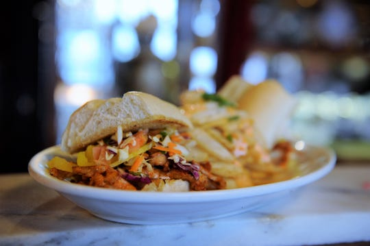 A Korean bahn mi sandwich with asian vegetable slaw and pork sauteed with gochujang sauce  is on the new menu at Cafe Arazu in Newburgh.