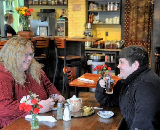 Lisa Polk and Wyatt Squires enjoy a pot of hot tea at Cafe Arazu in Newburgh on Thursday, Feb. 6, 2020.