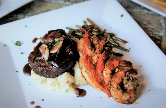 Beef filet with spiced shrimp on bread with romesco sauce is on the new menu at Cafe Arazu in Newburgh.