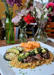South American Steak and Potatoes with chimichurri sauce, avocado, fried yuca and grilled vegetables  is on the new menu at Cafe Arazu in Newburgh.