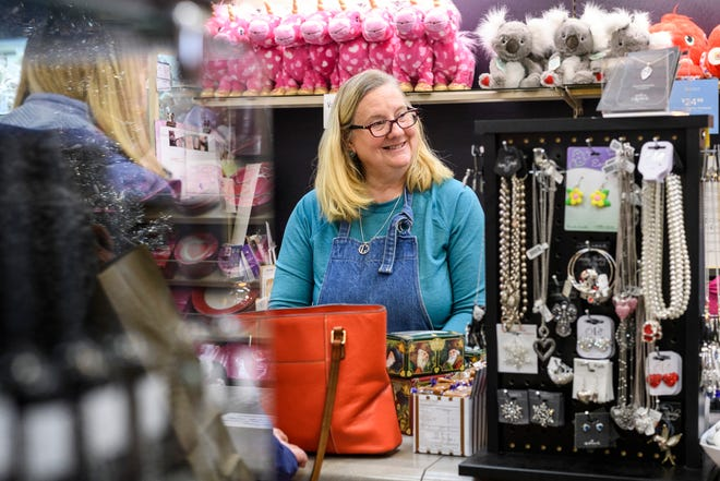 Penne Gambrall, center, talks with customers at her shop, Jennifer's Hallmark, located in the Lawndale Shopping Center on South Green River Road in Evansville, Ind., Monday afternoon, Feb. 17, 2020. After 44 years of operating as a local family-owned store, Gambrall and her sister and co-owner Jennifer Jones announced they will be going out of business.