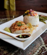 Ponzu Mahi Mahi with baby bok choy, sticky rice, vegetable slaw and orange-ginger green beans is on the new menu at Cafe Arazu in Newburgh.