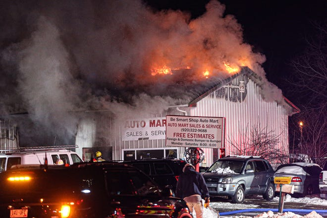 Firefighters battle a fire Saturday, Feb. 16, 2020, at Auto Mart on Van Dyne Road, Fond du Lac.