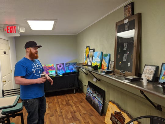 Loco Deli and Arts co-owner Zach Beckman shows off art gallery in restaurant featuring work for sale by local and state artists.