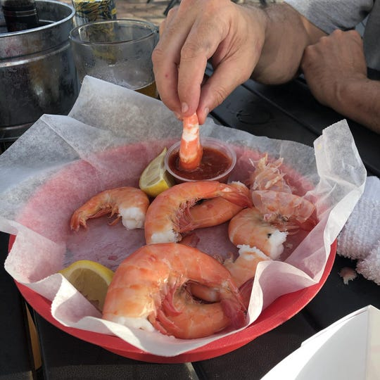 Tuckaway picks up its Gulf shrimp fresh from the shrimp docks beneath the Matanzas Pass Bridge.