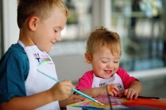 """Eleanor """"Ellie"""" O'Neal paints alongside her brother, Connor. Ellie is the child artist for the 2020 SWFL Wine & Food Fest."""