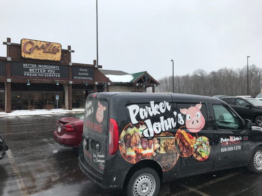 A Parker John's BBQ & Pizza van is parked outside Grazies Italian Grill, 2851 S. Oneida St., on Feb. 17. The Kiel-based, family-owned barbecue and pizza restaurant bought the Ashwaubenon building and intends to open its fourth Parker John's location.