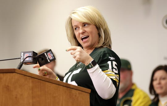 Kari Bernier, of Dyersburg, Tenn., speaks at the podium after being named the 2019 Packers FAN Hall of Fame inductee on Feb. 17, 2020, at Lambeau Field in Green Bay, Wis.