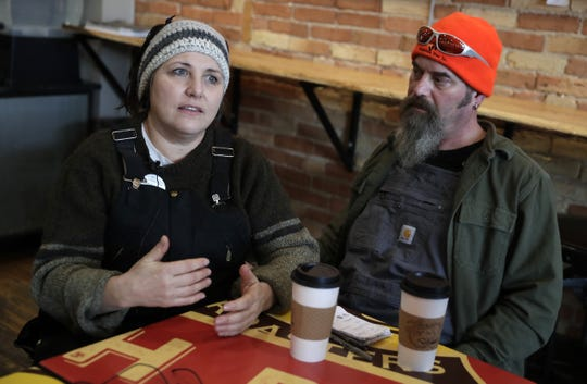 """Donna Yost, known as """"FarmHer Donna,"""" talks on Feb. 10, 2020, at Luna Cafe in De Pere about picking up food waste from businesses that she and Karl Fugere (right) will compost on their organic farm in Crivitz, Wis."""