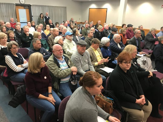 About 80 people crowd into a conference room at Greenville's County Square government building on Monday, Feb. 17, 2020, to show their opposition to the Farmers Cove tiny house development proposed on the shores of Lake Robinson outside Greer.