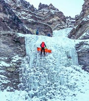 Specially trained rescuers descend a series of frozen waterfalls with an injured Billings climber Saturday in Wyoming. The rescue took at least nine hours.