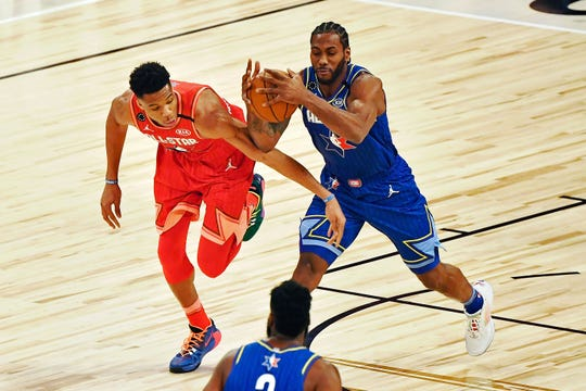 Feb 16, 2020; Chicago, Illinois, USA; Team LeBron forward Kawhi Leonard of the LA Clippers grabs the ball while under pressure from Team Giannis forward Giannis Antetokounmpo of the Milwaukee Bucks during the first quarter during the 2020 NBA All Star Game at United Center.
