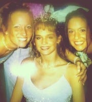 Nicole Richards (middle) was named prom queen at Perry Meridian High months after her accident.
