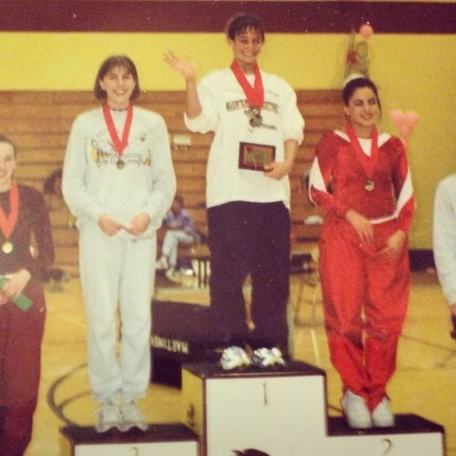 The last picture taken of Nicole Richards (middle) before her accident -- after she won the Bloomington Valentine's Invitational Feb. 12, 2000.