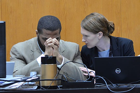 Defendant Willie Cory Godbolt, left, reacts during testimony from his 12-year-old daughter, My'Khyiah Godbolt, that he beat her while defense attorney Katherine Poor comforts him, on Monday, Feb. 17, 2020, during the third day of his capital murder trial at the Pike County Courthouse in Magnolia, Miss. Godbolt, 37, is on trial, for the May 2017 shooting deaths of eight people in Brookhaven.