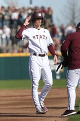 Mississippi State's Kamren James (6) talks with Mississippi State coach Kyle Cheesebrough. Mississippi State played Wright State at Dudy Noble Field in game 2 of the series on Saturday, February 15, 2020. Photo by Keith Warren
