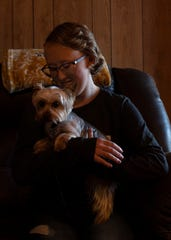 Hannah Reeves holds her dog in her home. Reeves is a St. Jude patient who is battling her cancer along with raising thousands for cancer awareness at St. Jude.