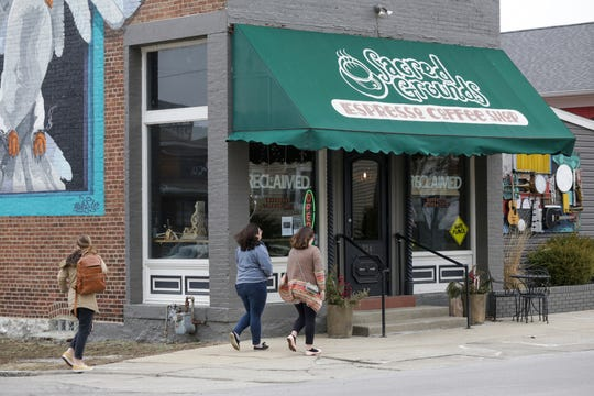 Customers walk into Sacred Grounds Reclaimed on Wabash Avenue, Monday, Feb. 17, 2020 in Lafayette.