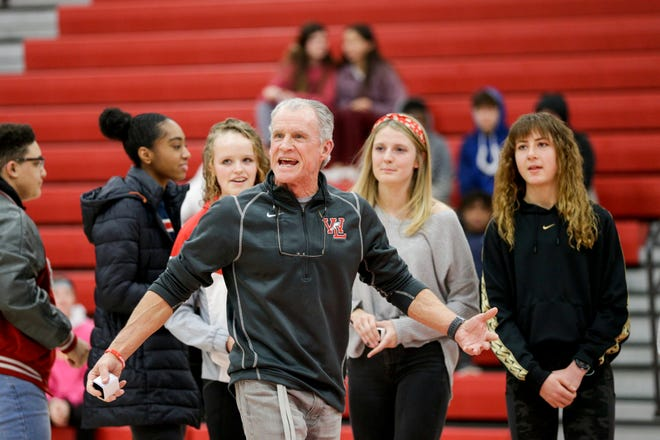Lane Custer, West Lafayette track and field coach, reacts after graduated members from his girls team received their 2019 IHSAA Girls track rings, Wednesday, Feb. 12, 2020 in West Lafayette.