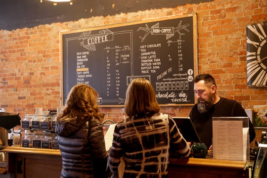 Trent O'Brien takes an order at Sacred Grounds Reclaimed on Wabash Avenue, Monday, Feb. 17, 2020 in Lafayette.