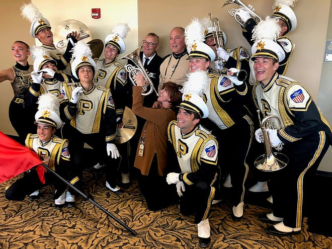 Marc and Sharon Hagle, center, pose with member of the Purdue 'All American' Marching Band. The couple has given $10 million toward a new, $20 million home for Purdue's band and orchestra program. Construction of Hagle Hall will begin in September 2020 and could be ready for Purdue's bands by March 2022.