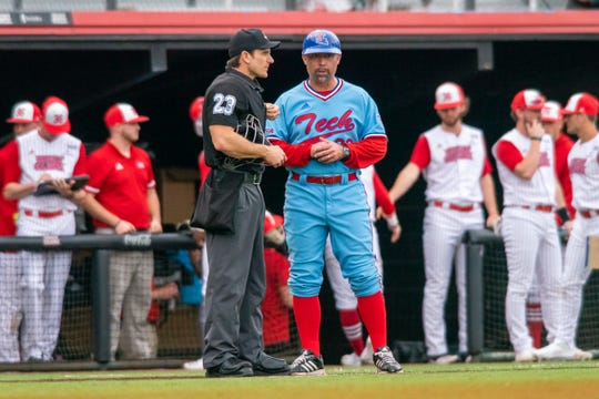 Louisiana Tech's head coach Lane Burroughs talks to an official on the field as the Ragin' Cajuns take on the LA Tech Bulldogs at M.L. Tigue Moore Field on Sunday, Feb. 16, 2020.