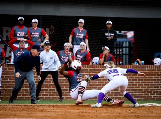 UL OF Taylor Roman is tagged out trying to return to 3rd base during the matchup between UL and LSU at Lamson Park in Lafayette, Louisiana on February 15, 2020.