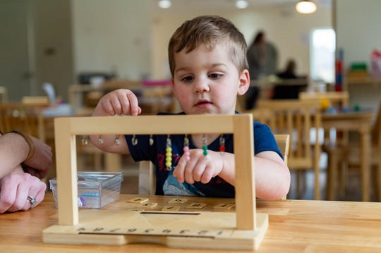 Rowan Boudreaux, 3, works through a math activity at Montessori of Acadiana, a new early childhood education center in Lafayette, Thursday, Feb. 13, 2020.
