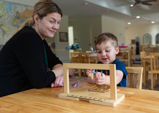 Montessori of Acadiana Director Jen Perkins helps Rowan Boudreaux, 3, complete a math activity Thursday, Feb. 13, 2020.