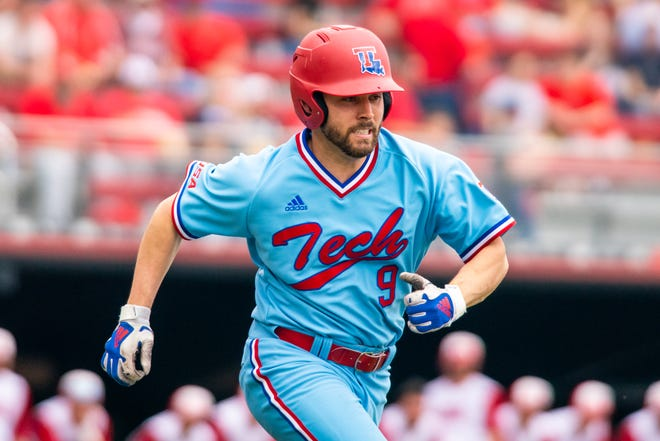 Louisiana Tech's Hunter Wells runs to first base as the Ragin' Cajuns take on the LA Tech Bulldogs at M.L. Tigue Moore Field on Sunday, Feb. 16, 2020.