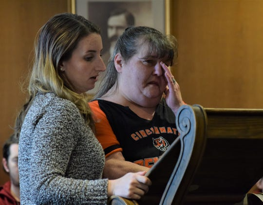 Melody Delaney, left, reads a letter from Sherry Hettinger, right, to the court during Chad Kerens' sentencing hearing on Feb. 17. Kerens was on trial for murdering Hettinger's fiance in April 2019.
