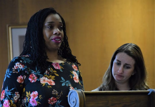 Davia Anderson, left, addresses the court, while Melody Delaney, victim's assistance specialist with the Fairfield County Prosecutor's Office, right, stands with her during Chad Kerens' sentencing hearing Feb. 17. Kerens was on trial for murdering Anderson's father in April 2019. He was sentenced to life in prison.