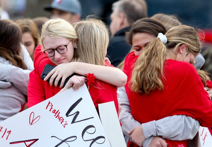 Ceci Kamer, left, and other members of KIVA mourn during  a procession for Lesley Prather and her daughter, Rhyan, along with Carrie McCaw and her daughter, Kacey. All four were killed in a car crash in Missouri. Feb. 17, 2020