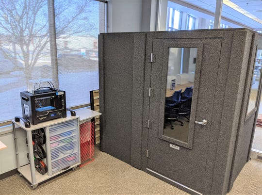 Sound booth and 3D printer inside The Idea Box at Manitowoc Public Library.