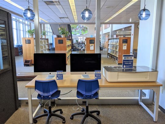iMacs and Glowforge 3D laser printer inside The Idea Box at Manitowoc Public Library.