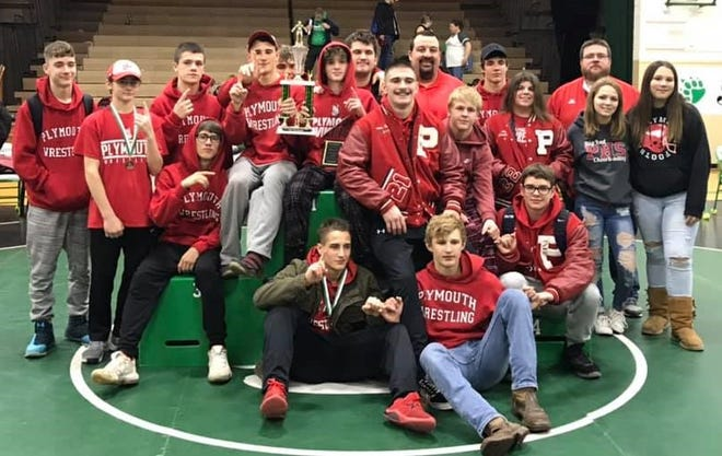 Coach Jeremiah Balkin (back row, third from right) and his Plymouth Big Red celebrate their fifth tournament title of the 2019-20 season at the Margaretta Invitational.