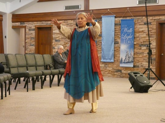 Francine Butler dances at a combined worship service held at Marion Bible Fellowship Saturday. The church invited members of black churches to the two-hour service Saturday in honor of Black History Month.