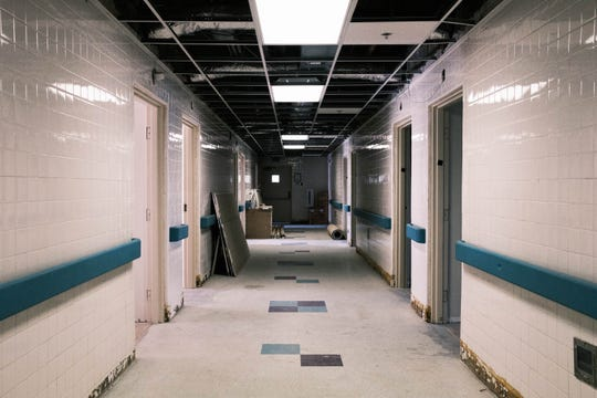 The halls in Collins Chapel Hospital show completed renovations, as well as work that still needs to be done to bring the facility back to life.