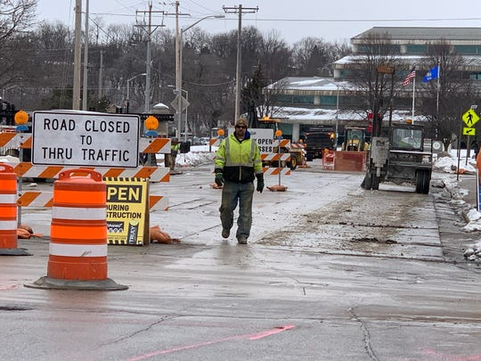 Construction crews break into old pavement, mark the road and survey the area as work gets underway on Barstow Street north of Main Street on Feb. 17, 2020. The earliest part of the first stage of the project involves work on new water mains near North Street and near Main Street in downtown Waukesha.