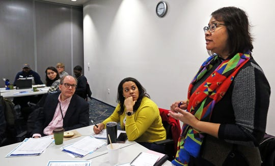 Georgina Manley, right, partnerships coordinator for the U.S.  Census, takes questions from participants attending a census training session in Milwaukee.
