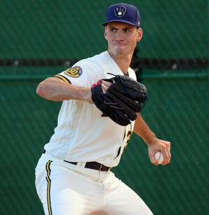 Brewers pitcher Brent Suter throws during spring training Sunday. Suter avoided arbitration by signing a two-year contract.