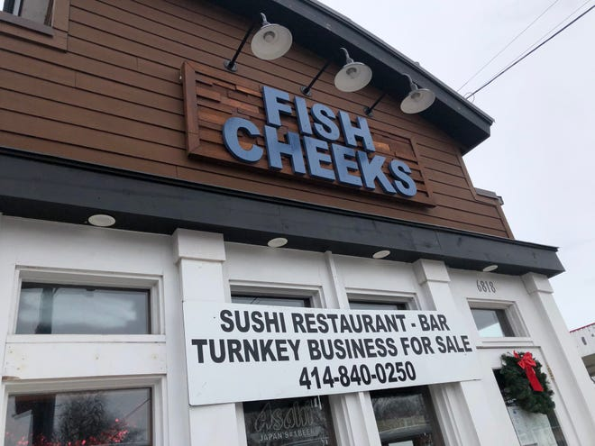 "A sign at Fish Cheeks, 6818 W. North Ave., Wauwatosa, said the business is for sale. The owner of the restaurant said the sushi bar was ""temporarily closed."""