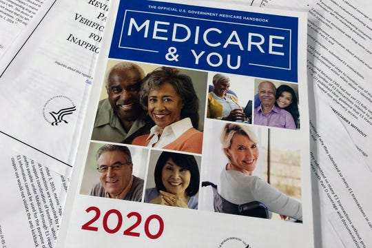 The Official U.S. Government Medicare Handbook for 2020 is seen resting atop a recent report issued by the Department of Health and Human Services' Office of the Inspector General. A government watchdog tells The Associated Press it will launch a nationwide audit that may shed light on how seniors' personal Medicare information is getting to telemarketers, raising concerns about fraud and waste.