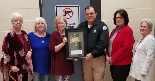 The Marion County Heritage Society recently presented a framed photo of former sheriff Jack Pace to the Marion County Sheriff's Office. Shown above are (from left) Lou Ann Ott, Judith Lawrence, Shelley Ledbetter, Sheriff Clinton Evans, Janice Duffy, and Sharron Patton.