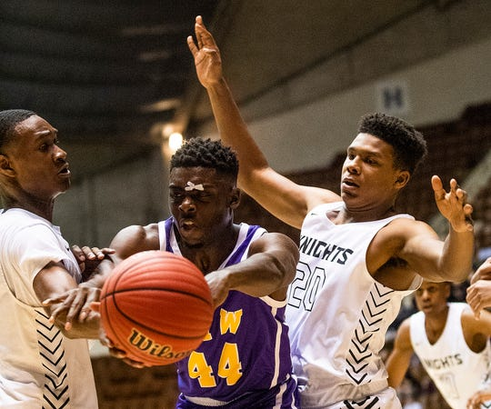 B.T. Washington's Kendrick Calhoun (44) is double teamed by Catholic's Justin Bufford (1) and Darian Riley (20) in AHSAA regional basketball action in Montgomery, Ala., on Monday February 17, 2020.
