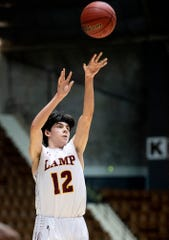 LAMP's Mitchell Sloane (12) shoots a three point shot against Montevallo in AHSAA regional basketball action in Montgomery, Ala., on Monday February 17, 2020.
