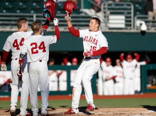 Alabama freshman slugger Owen Diodati (16) celebrates with teammates Zane Denton (44) and Kolby Robinson (24) following a two-run home run in a 10-0 shutout of Northeastern on Friday, Feb. 14, 2020 at Sewell-Thomas Stadium in Tuscaloosa.