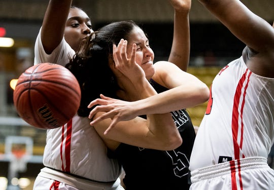 Prattville Christian's Tori DeMaio (5) is double teamed by T.R. Miller in AHSAA regional basketball action in Montgomery, Ala., on Monday February 17, 2020.